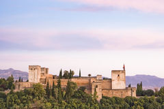 The Alhambra at dusk. The Alhambra in Granada viewed from  the Mirador de San Nicolas Royalty Free Stock Image