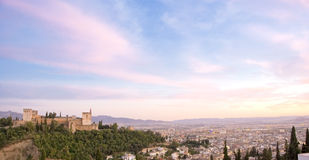 The Alhambra at dusk. The Alhambra and the city of Granada viewed from  the Mirador de San Nicolas Royalty Free Stock Photo