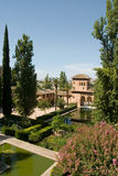 Alhambra Gardens. The buildings of the Alhambra were originally whitewashed however, the buildings now seen today are reddish. The first reference to the Qal� Stock Image