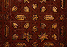 Alhambra: gold engraving. Gold and wood wall at the Alhambra, Granada, Spain Stock Photos