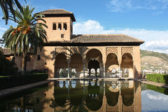 Alhambra in Granada. Beautiful arabic style palace with water reflection in the Alhambra in Granada, Spain royalty free stock photos