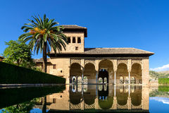 Alhambra in Granada. One of the palaces in the extensive area of the Alhambra with a pond in the foreground stock photography