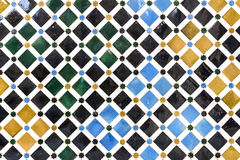 The Alhambra in Granada, Spain. Decorated tiles with geometric shapes in various colors in the Alhambra, Andalusia, Spain Stock Images