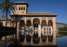 Alhambra Granada Spain palaces Nazaries, symmetrical reflection in the mirror of water royalty free stock photos