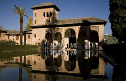 Alhambra - Granada - Spain. Portico and pool of the early 14th-century Partal, in the Alta Alhambra of the Alhambra complex is visited by the tourists, in royalty free stock image