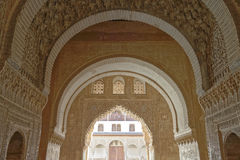 Alhambra interior. Image taken of a long series of arches in a passageway leading to the Lion courtyard in la Alhambra,  a UNESCO World Heritage Site, Granada Stock Photography