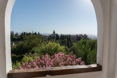 Alhambra Islamic Royal Palace, Granada, Spain. 16th century. View Of The Ancient Fortress Of The Alhambra Islamic Royal Palace, With Trees And Flowers Granada Royalty Free Stock Photography