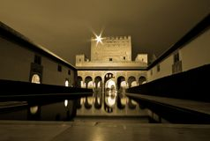Alhambra at night, Andalusia, Spain. A view of the Moorish Palace reflecting in the water at night, Alhambra in Granada, Spain royalty free stock photo