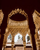 Alhambra palace. A view showing full decorated pillars arches and ceiling of famous Alhambra palace, Granada, Andalusia, Spain Stock Photography