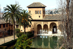 Alhambra Palace. Palm Trees and Archways Reflected in a Pool at the Alhambra Palace, Granada, Spain Stock Images