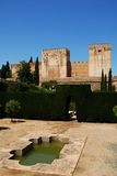 Alhambra Palace Castle and Garden, Granada. Castle featuring Torre Quebrada and Torre del Homenaje castle towers (Broken tower and Tower of Homage) with an royalty free stock image
