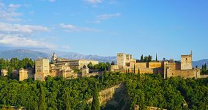 The Alhambra palace and fortress at sunrise hour, Granada, Spain. Royalty Free Stock Images