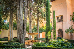 Alhambra palace garden in southern Spain. Nice courtyard in  Alhambra Palace in Spain Royalty Free Stock Photography