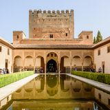 Alhambra Palace Gardens Granada Spain. Granada, SPAIN - Aug, 2015: Beautiful reflection of the Alhambra palace in the coutyard pool stock photography