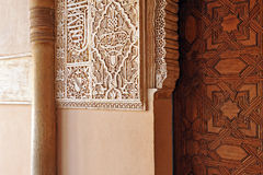 The Alhambra Palace in Granada, Andalusia, Spain. Arab art, plasterwork and tracery of a wooden door, Palace of Alhambra in Granada, Andalucia, Spain Stock Images