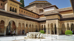 Alhambra palace in Granada, Spain. Cort of lions that is the most recognisable part of the Alhambra palace in Granada, Spain Stock Photos