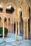 Alhambra Palace in Granada. GRANADA, SPAIN - FEBRUARY 15, 2013: Mosaic walls and columns at the Alhambra Palace. These decorations ushered in the last great Stock Photography