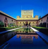 Alhambra Palace in Granada, Spain. Alhambra Palace with pool in Granada, Spain royalty free stock photography