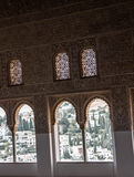 Alhambra Palace. #alomgrrphotography ,Interior wall of Alhambra palace and a view of Granada through the arch Stock Image
