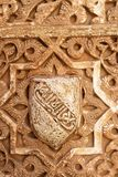 Alhambra Palace wall detail. Decorative carving in wall plaster work in the Nasrid Palace, Palace of Alhambra, Granada, Granada Province, Andalusia, Spain Royalty Free Stock Photo