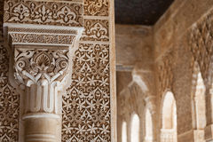 Alhambra Patio of the Lions column detail. Patio of the lions column and arch detail from the Alhambra in Granada, Spain Royalty Free Stock Photo