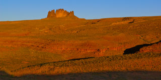 Alhambra Rock the Guardian of San Juan. A view of Utah`s Alhambra Rock from its northeast flank just after sunrise. It is located just southwest of the town of Royalty Free Stock Images