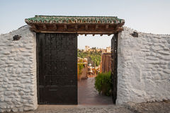 Alhambra seen through doors in Granada Stock Image