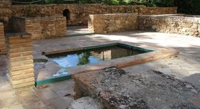Alhambra small pool. A small pool in a stone courtyard in the Alhambra Stock Photo