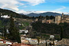 Alhambra and snowing Sierra Nevada mountains under a lenticular Royalty Free Stock Photography