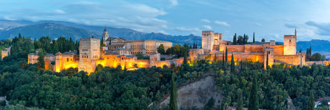 Alhambra at sunset in Granada, Andalusia, Spain. Panorama of Moorish palace and fortress complex Alhambra with Comares Tower, Alcazaba, Palacios Nazaries and Royalty Free Stock Photos