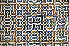 Alhambra tile detail. Detailed background  of the intricate tile patterns on a wall of the Alhambra Palace, Granada, Spain Royalty Free Stock Images