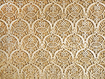 Alhambra wall detail. Detailed background  of the intricate patterns on a wall of the Alhambra Palace, Granada, Spain Royalty Free Stock Photo