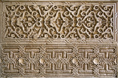 Alhambra wall panel. Detailed panel of the intricate patterns on a wall of the Alhambra Palace, Granada, Spain Stock Images