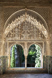 Alhambra windows. A view to the courtyard through arched windows. Alhambra Palace, Granada, Andalucia, Spain Stock Photos