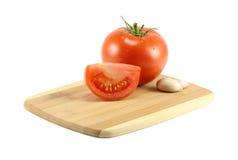 Alho e tomates Imagens de Stock