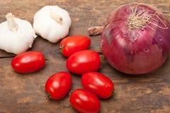Alho e tomates da cebola Imagens de Stock Royalty Free