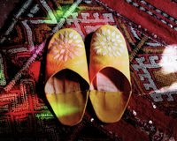 Ali baba. Oriental house shoes on a moroccan rug Stock Photo