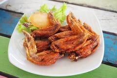 Ali di pollo fritto deliziose Fotografia Stock