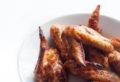 Ali di pollo su fondo bianco Immagini Stock Libere da Diritti