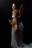 Ali 2 di signora e della farfalla di Pregnan fotografie stock libere da diritti