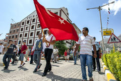 Ali Gurbuz carries a Turkish flag during a parade down the main street of Elmali in Turkey. Ali Gurbuz, the 2010 champion of the Elmali Turkish Oil Wrestling Stock Photo