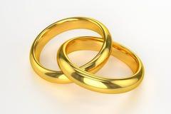Alianças de casamento douradas Foto de Stock Royalty Free