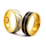Alianças de casamento ouro, prata, e preto e prata Foto de Stock Royalty Free