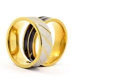 Alianças de casamento ouro, prata, e preto e prata Fotografia de Stock Royalty Free