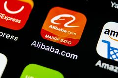 Alibaba application icon on Apple iPhone X smartphone screen close-up. Alibaba app icon. Alibaba.com is popular e-commerce applica. Sankt-Petersburg, Russia, May royalty free stock image