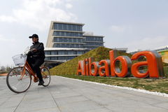 Alibaba Group. A safe-guard rides a bike to patrol at Alibaba Group,an e-commerce giant company in China