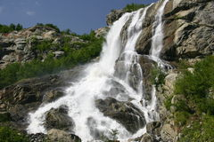 Alibeksky falls. The photo is made in settlement Dombai in mountains of the North Caucasus Royalty Free Stock Photo