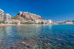 Alicante Bay. Crystal clear water in Alicante Bay with Santa Barbara castle in background stock photo