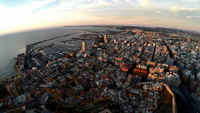 Alicante city overview during sunrise. Spain. Aerial View of seaside part of Alicante and port. Spain Royalty Free Stock Photos
