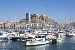 Alicante city view. A view of the beautiful marina of Alicante, crowded with boats, and with the castle of Santa Barbara dominating the scene Stock Photo